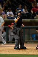 Umpire Jonathan Parra calls a strike during a Southern League game between the Chattanooga Lookouts and Birmingham Barons on May 2, 2019 at Regions Field in Birmingham, Alabama.  Birmingham defeated Chattanooga 4-2.  (Mike Janes/Four Seam Images)