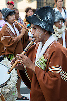 Lima, Peru.  Young Man Playing the Flute in an Andean Cultural Parade, Plaza de Armas.