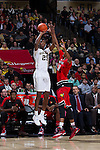 Cornelius Hudson (25) of the Wake Forest Demon Deacons shoots over Shaqquan Aaron (21) of the Louisville Cardinals  during first half action at the LJVM Coliseum on January 4, 2015 in Winston-Salem, North Carolina.  The Cardinals defeated the Demon Deacons 85-76.  (Brian Westerholt/Sports On Film)
