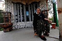 """Dule / Srebrenica / Bosnia orientale 2011..Una contadina del villaggio di Dule beneficiaria del progetto """"TransuManza di pace"""" che promuove la ripresa delle attività agricole tra i contadini dell'area di Srebrenica. Sullo sfondo l'elenco degli abitanti del villaggio uccisi durante la guerra dal 1992 al 1995..Foto Livio Senigalliesi..Suceska / Srebrenica / BIH 2011.Farmer in the village Dule beneficiary of project of development of agriculture in the area of Srebrenica..In the background the names of Dule' inhabitants killed during the war..Photo Livio Senigalliesi"""