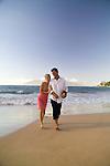 Couple on the beach at the Four Seasons Wailea, Maui, Hawaii