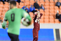 Houston, TX - Friday December 9, 2016: Alex Underwood (23) of the Denver Pioneers reacts to missing a shot on goal in the first half against the Wake Forest Demon Deacons at the NCAA Men's Soccer Semifinals at BBVA Compass Stadium.
