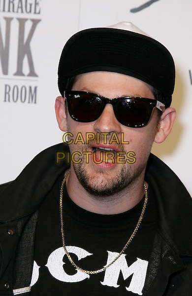 JOEL MADDEN .Mario Barth's King Ink Grand Opening at the Mirage Resort Hotel and Casino, Las Vegas, Nevada, USA, 10th April 2010.portrait headhoht  DCMA t-shirt black and white sunglasses beard facial hair mouth open funny Ray Bans Wayfarers gold chain necklace  .CAP/ADM/MJT.© MJT/AdMedia/Capital Pictures.