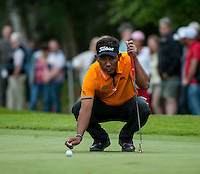 23.05.2015. Wentworth, England. BMW PGA Golf Championship. Round 3.  Thongchai Jaidee [THA] lines up a putt on the 4th green during the third round of the 2015 BMW PGA Championship from The West Course Wentworth Golf Club