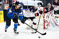 American Jacob Trouba (C) and Finland's Mikko Rantanen (L) fight for the puck during the Ice Hockey World Championship quarter-final match between the US and Finland in the Lanxess Arena in Cologne, Germany, 18 May 2017. Photo: Marius Becker/dpa /MediaPunch ***FOR USA ONLY***