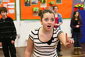 "Drama group for 8-13s run by Yvonne Arnaud Theatre, rehearsing a production of ""Alice"" in a school hall, Guildford, Surrey."