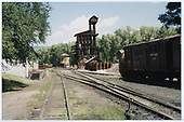 View north at Chama yard showing tank, coaling tower and Rotary OY.<br /> C&amp;TS  Chama yard, NM
