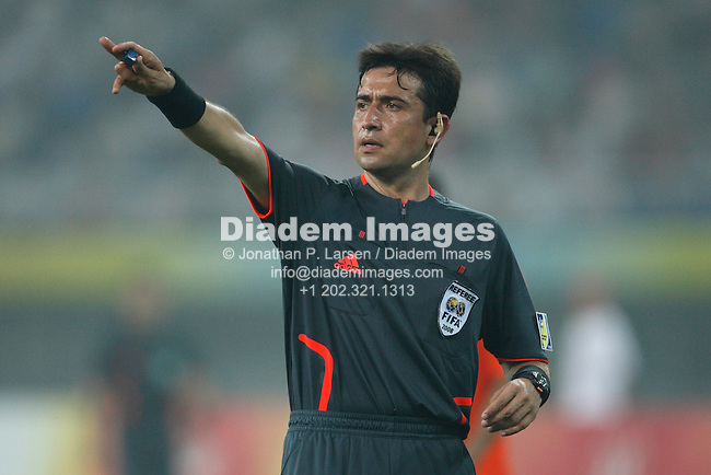 TIANJIN, CHINA - AUGUST 7:  Referee Pablo Pozo makes a possession call during a Group B match between Nigeria and the Netherlands at the Beijing Olympic Games soccer tournament August 7, 2008 in Tianjin, China.  (Photograph by Jonathan P. Larsen)