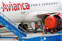 RIONEGRO, COLOMBIA - MAY 12: Several operators with Avianca airline wear facial mask on the runway of José María Córdoba International Airport on May 12, 2020 in Rionegro. Avianca filed for bankruptcy in the United States on May 11, 2020 to reorganize its debt due to the impact of the coronavirus pandemic. (Photo by Fredy Builes / VIEWpress via Getty Images)