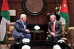 Palestinian President Mahmoud Abbas is welcomed by Jordan's King Abdullah II in the capital Amman, on July 24, 2019. Photo by Thaer Ganaim