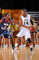 25 February 2012:  FIU guard DeJuan Wright (14) handles the ball while being defended by South Alabama guard Dallas Jones (2) in the first half as the FIU Golden Panthers defeated the University of South Alabama Jaguars, 81-74, at the U.S. Century Bank Arena in Miami, Florida.