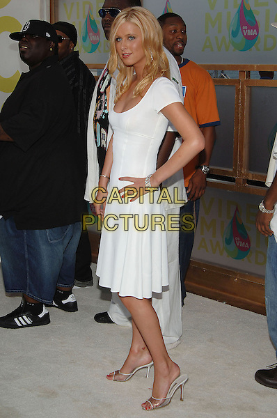 NICKY HILTON.MTV Video Music Awards.Arrivals held at the American Airlines Arena,.Miami, 28th August 2005.full length white dress blonde hair hand hip.Ref: ADM/JW.www.capitalpictures.com.sales@capitalpictures.com.© Capital Pictures.