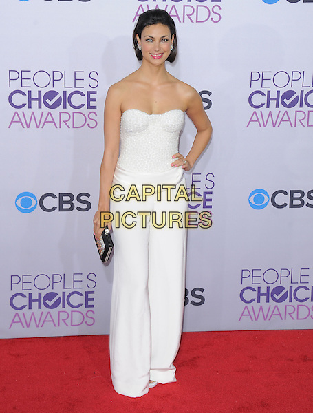 Morena Baccarin.The 2013 People's Choice Awards held at Nokia Live in Los Angeles, California 9th January 2013                                                                   .full length strapless white trousers jumpsuit hand on hip clutch bag silver black .CAP/DVS.©DVS/Capital Pictures.