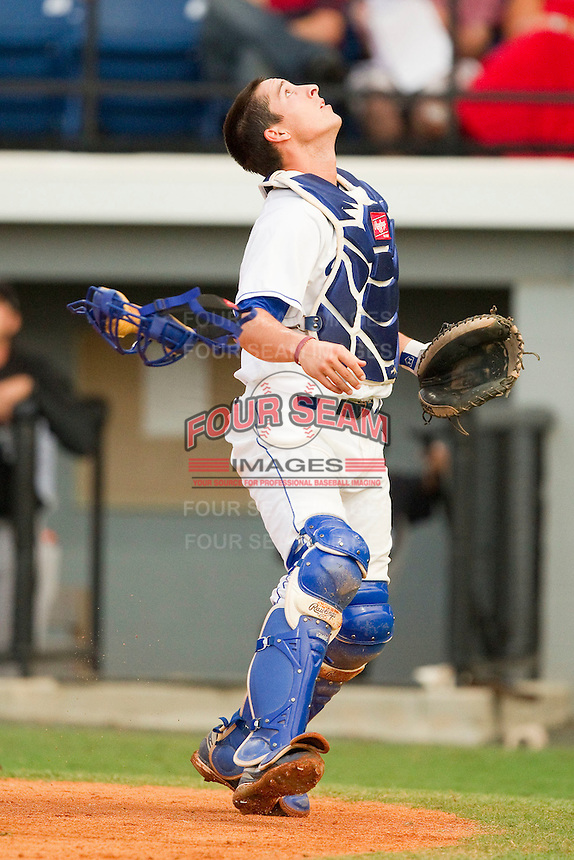 Burlington Royals catcher Beau Maggi #38 tosses his mask as he tracks a foul pop fly during the Appalachian League game against the Bristol White Sox at Burlington Athletic Park on July 6, 2012 in Burlington, North Carolina.  The Royals defeated the White Sox 5-2.  (Brian Westerholt/Four Seam Images)