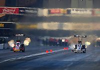 Feb 13, 2016; Pomona, CA, USA; NHRA top fuel driver Shawn Langdon (left) races alongside Morgan Lucas during qualifying for the Winternationals at Auto Club Raceway at Pomona. Mandatory Credit: Mark J. Rebilas-USA TODAY Sports