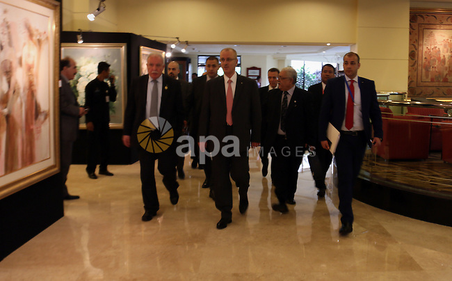 A handout picture released by Prime Minister Office shows Palestinian Prime Minister Rami Hamdallah meets with Indonesian President, in the West Bank city of Ramallah on April 21, 2015. Photo by Prime Minister Office. Photo by Prime Minister Office