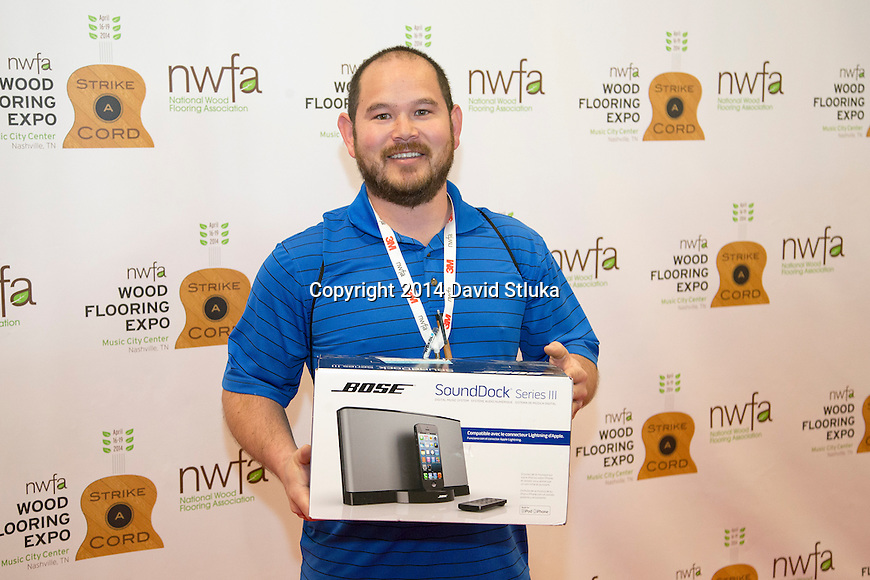 Jason Namba was the winner of the Bose iPhone dock during the 2014 NWFA Expo Friday, April 18, 2014 in Nashville, Tennessee. (Photo by David Stluka)