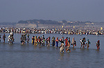 Pilgrims bathing at the Sangam.It was estimated that 30 million pilgrims visited the Maha Kumbha Mela in 1989 making it the largest gathering of any kind in modern history.Sadhus holy men and pilgrims come to bathe at the Sangam where the Ganges,Yamuna and Saraswati Rivers meet. Maha Kumbha Mela is held every twelve years at Prayag (Allahabad) in Uttar Pradesh in India.