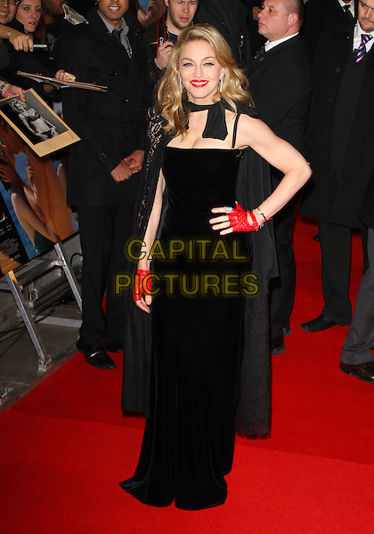Madonna.W.E. Uk film premiere at Odeon cinema, Kensington, London, England..11th January 2011.full length dress cape red fingerless leather glove black lace red hand on hip.CAP/ROS.©Steve Ross/Capital Pictures.