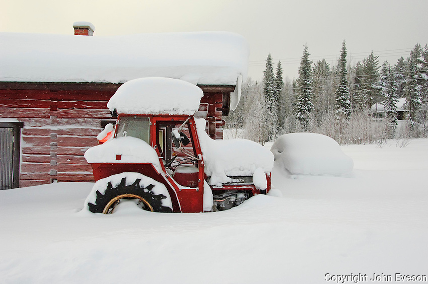 Tractor covered in snow, Lapland.....Copyright..John Eveson, Dinkling Green Farm, Whitewell, Clitheroe, Lancashire. BB7 3BN.01995 61280. 07973 482705.j.r.eveson@btinternet.com.www.johneveson.com