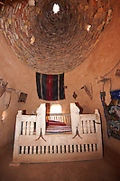 "Pictures of the beehive adobe buildings of Harran, south west Anatolia, Turkey.  Harran was a major ancient city in Upper Mesopotamia whose site is near the modern village of Altınbaşak, Turkey, 24 miles (44 kilometers) southeast of Şanlıurfa. The location is in a district of Şanlıurfa Province that is also named ""Harran"". Harran is famous for its traditional 'beehive' adobe houses, constructed entirely without wood. The design of these makes them cool inside. 3"