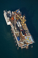 aerial photograph of Platform Esther , owned by DCOR; the platform is located approximately 1.5 miles California coast off shore of Seal Beach, Orange County, California