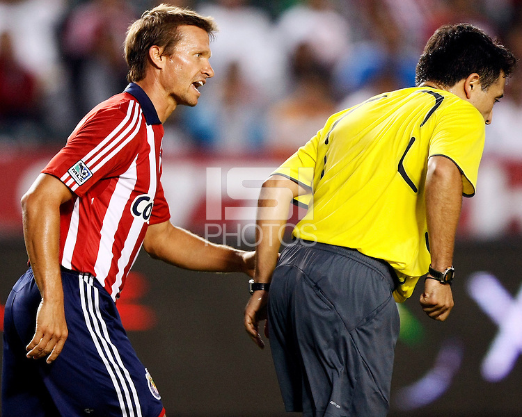 Chivas USA midfielder, Jesse Marsch(15) exchanges words with Head referee Mauricio Navarro during the game. Chivas USA  took on the NY Red Bulls on June 28, 2008 at the Home Depot Center in Carson, CA. The game ended in a 1-1 tie.