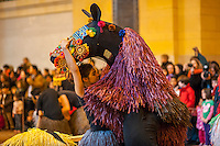 "A dancer prepares to put on a colorful horse costume to perform in ""Heard-NY"" by performance artist Nick Cave and choreographer William Gill in Vanderbilt Hall of Grand central Terminal in New York on Tuesday, March 26, 2013. The costumes made of fabric are each inhabited by two dancers from the Alvin Ailey School who meander around the hall like a herd of horses. Cave is known for his ""soundsuits"", costumes which are sculptures that make noise as the wearer moves about. The performances are twice a day at 11AM and 2PM until March 31. © Richard B. Levine)"
