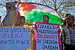 Israeli peace activists protest against the eviction of Palestinian families from their homes & the subsequent occupation of the buildings by Jewish settlers in the Sheikh Jarrah neighbourhood of East Jerusalem on 16/07/2010.