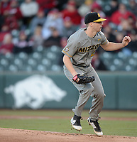 NWA Democrat-Gazette/ANDY SHUPE<br /> Missouri starter Jacob Cantleberry leaps on the mound Friday, March 15, 2019, after delivering a pitch to the plate during the first inning against Arkansas at Baum-Walker Stadium in Fayetteville. Visit nwadg.com/photos to see more photographs from the game.