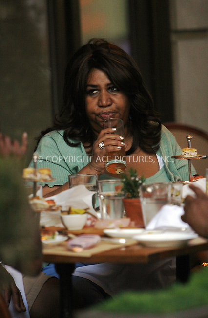 WWW.ACEPIXS.COM . . . . .  ....April 27 2009, New York City....EXCLUSIVE - ALL ROUNDER....Singer Aretha Franklin seen in a restaurant in Manhattan on April 27 2009....Please byline: NANCY RIVERA- ACE PICTURES.... *** ***..Ace Pictures, Inc:  ..tel: (212) 243 8787 or (646) 769 0430..e-mail: info@acepixs.com..web: http://www.acepixs.com