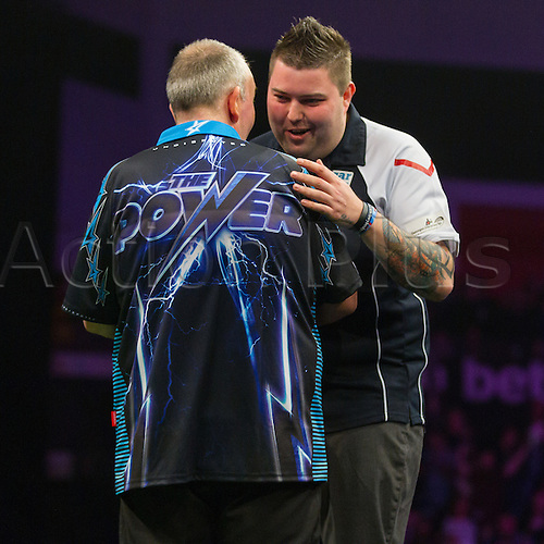 31.03.2016. The Motorpoint Arena, Cardiff.  Betway PDC Premier League Darts Judgement Night. Michael Smith congratulates Phil Taylor after the match