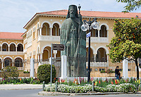 CYPRUS, capital Nicosia (Lefkosia): Archbishop Makarios III. monument in front of Archbishopric Palace at Archbishop Kiprian&oacute;s  Square. Makarios resided here as Archbishop and first President of independent Cyprus until 1977<br />
