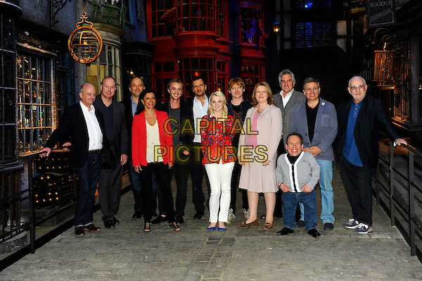 Tom Felton, Evanna Lynch, Rupert Grint and Warwick Davis & cast & crew members.Photocall during a press visit/junket at Warners Bros Studio Tour - The Making of Harry Potter at Leavesden Studios, Watford, Hertfordhire, England..March 29th 2012.full length black white red grey gray suit jacket top denim.CAP/CJ.©Chris Joseph/Capital Pictures.