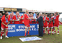 Mark Roberts of Stevenage Borough receives the Blue Square Premier championship trophy  from Brian Lee after the Blue Square Premier match between Stevenage Borough and York City at the Lamex Stadium, Broadhall Way, Stevenage on Saturday 24th April, 2010..© Kevin Coleman 2010 ..