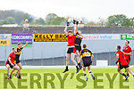 Alan O'Sullivan Dr Crokes tackles and Griffin Wharton Kenmare Shamrocks contends the dropping ball during their SFC QF in Fitzgerald Stadium on Sunday