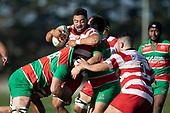 Seluini Molia is tackled by Dan Hyatt and Joseph Gregory. Counties Manukau Premier Club Rugby game between Karaka and Waiuku, played at Karaka Sports Park on Saturday June 9th 2018. Karaka won the game 22 - 18 after trailing 5 - 13 at halftime.  Photo by Richard Spranger.