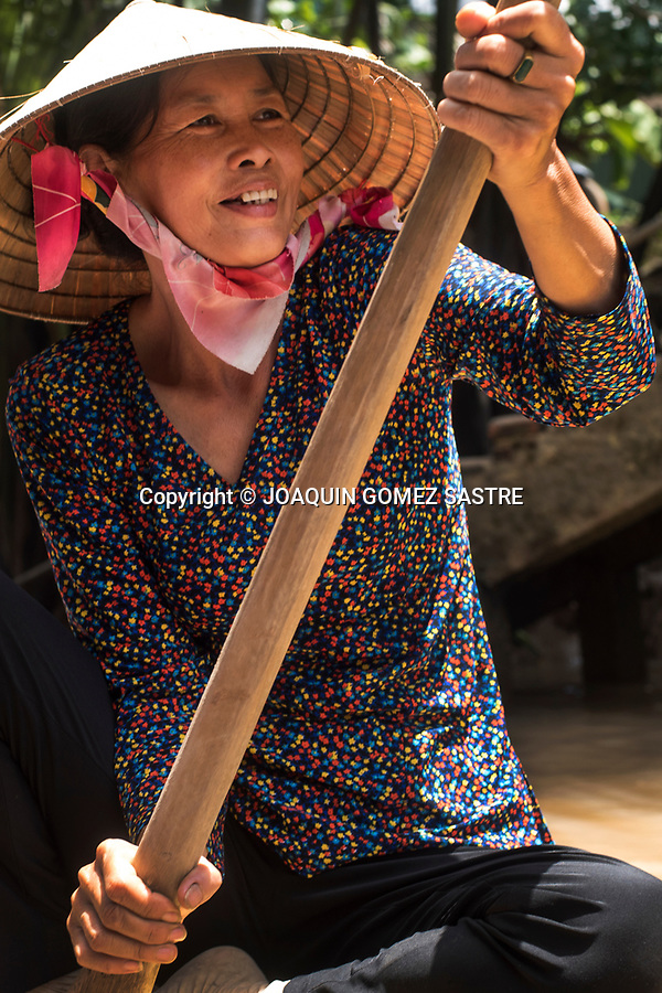 Portrait of a woman driving a boat down the Mekong Delta near Ho Chi Minh City (Vietnam).<br /> HO CHI MINH-VIETNAM