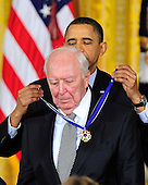 """United States President Barack Obama and first lady Michelle Obama present the 2010 Medal of Freedom, """"the Nation's highest civilian honor presented to individuals who have made especially meritorious contributions to the security or national interests of the United States, to world peace, or to cultural or other significant public or private endeavors"""", to American artist Jasper Johns in a ceremony in the East Room of the White House in Washington, D.C. on Tuesday, February 15, 2011..Credit: Ron Sachs / CNP"""