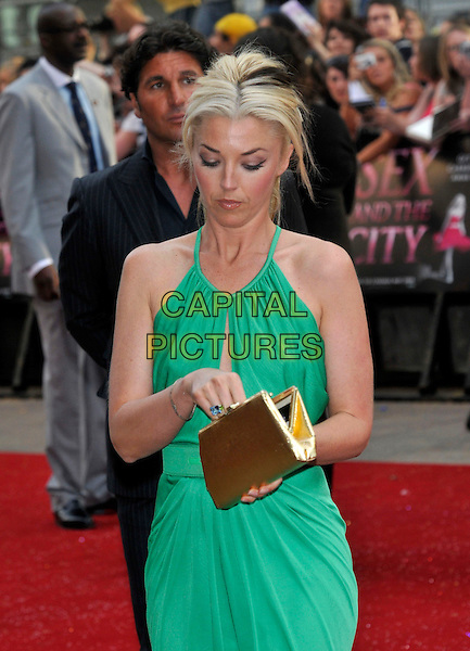 "TAMARA BECKWITH .Red Carpet Arrivals at the ""Sex And The City"" Movie World Premiere, Odeon Leicester Square, London, England, UK,.May 12th 2008..half length green dress gold purse looking down clutch bag.CAP/PL.©Phil Loftus/Capital Pictures"