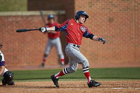 Jesse Uttendorfer (2) of the NJIT Highlanders follows through on his swing against the High Point Panthers at Williard Stadium on February 18, 2017 in High Point, North Carolina. The Panthers defeated the Highlanders 11-0 in game one of a double-header. (Brian Westerholt/Four Seam Images)