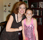 CORAL GABLES, FL - OCTOBER 20: Congresswoman / author Debbie Wasserman Schultz poses with her daughter Shelby Schultz as she speaks and signs copies of her book 'For the Next Generation: A Wake-Up Call to Solving Our Nation's Problems' at Coral Gables Congregational Church hosted by Books & Books on October 20, 2013 in Coral Gables, Florida. (Photo by Johnny Louis/jlnphotography.com)