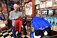 NWA Democrat-Gazette/FLIP PUTTHOFF <br /> COATS FOR ALL<br /> Gary Townzen shows Tuesday Nov. 27 2018 some of the coats for children and adults donated so far at his barbershop, Townzen Barbershop, at First and Walnut streets in downtown Rogers. Townzen has held an annual coat drive for 27 years. Coats that are new or in excellent condition can be donated at the barbershop. Coats are distributed through Samaritan Community Center and the Rogers school district.