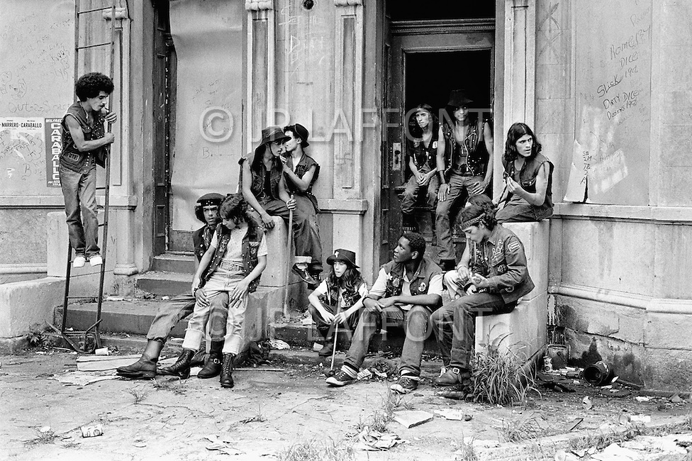 July 1972, The Bronx, New York City, New York State, USA --- Members of the New York street gang Savage Skulls. The trademark of the, primarily Puerto Rican, gang was a sleeveless denim jacket with a skull and crossbones design on the back. Based around Fox Street, in the popular South Bronx neighbourhood, the gang declared war on the drug dealers that operated in the area. Running battles were frequent with rival gangs Seven Immortals, and Savage Nomads. --- Image by © JP Laffont