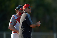 Illinois State Redbirds head coach Bo Durkac makes a pitching change as catcher Nick Zouras (14) looks on during a game against the Ohio State Buckeyes on March 5, 2016 at North Charlotte Regional Park in Port Charlotte, Florida.  Illinois State defeated Ohio State 5-4.  (Mike Janes/Four Seam Images)