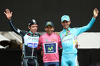 ITALIA. 01-06-2014. Nairo Alexander  Quintana Rojas -Col- (Movistar) celebra como campeón general de la versión 97 del Giro de Italia hoy 22 de mayo de 2014. A su izquierda Rigoberto Urán subcampeón y Fabio Aru a su derecha tercero. / Nairo Alexander  Quintana Rojas -Col- (Movistar)celebrates as champion of the 97th version of Giro d'Italia today May 22th 2014. At his left Rigoberto Uran second and Fabio Aru third in the standings.  Photo: VizzorImage/ Fabio Ferrari / LaPresse<br /> VizzorImage PROVIDES THE ACCESS TO THIS PHOTOGRAPH ONLY AS A PRESS AND EDITORIAL SERVICE AND NOT IS THE OWNER OF COPYRIGHT; ANOTHER USE HAVE ADDITIONAL PERMITS AND IS  REPONSABILITY OF THE END USER