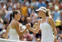 28-6-08, England, Wimbledon, Tennis,  Caroline Wozniacki congretulates Jelena Jankovic(L) with her victory