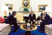 United States President Bill Clinton meets with US Representative Martin Meehan (Democrat of Massachusetts), left, and US Representative Chris Shays (Republican of Connecticut), right, in the Oval Office of the White House in Washington, DC on May 12, 1998.<br /> Mandatory Credit: Robert McNeely / White House via CNP