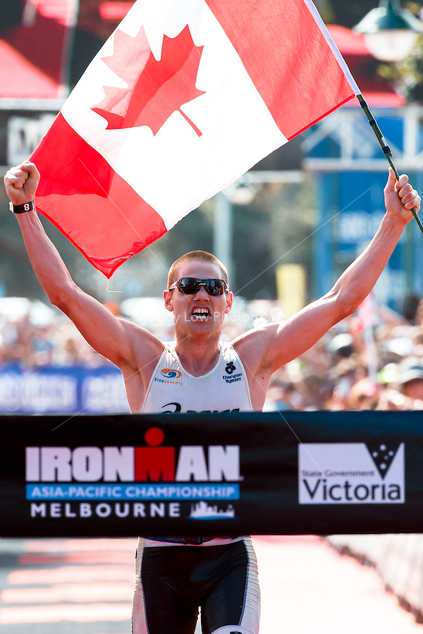 MELBOURNE, March 21, 2015 - Jeff SYMONDS (CAN) #8 crosses the finish line to win the 2015 IRONMAN Asia-Pacific Championship in Melbourne, Australia on Sunday March 21, 2015. (Photo Sydney Low / sydlow.com)