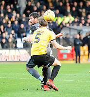 Lincoln City's Michael Bostwick vies for possession with Cambridge United's Greg Taylor<br /> <br /> Photographer Andrew Vaughan/CameraSport<br /> <br /> The EFL Sky Bet League Two - Cambridge United v Lincoln City - Saturday 29th December 2018  - Abbey Stadium - Cambridge<br /> <br /> World Copyright © 2018 CameraSport. All rights reserved. 43 Linden Ave. Countesthorpe. Leicester. England. LE8 5PG - Tel: +44 (0) 116 277 4147 - admin@camerasport.com - www.camerasport.com